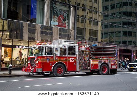 New York, United States of America - November 20, 2016: A fire truck standing in the streets of Manhattan