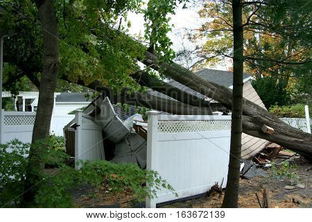 A house in Babylon Village NY has a tree fall on it's garage during Super Storm Sandy