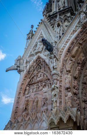 Metallic gargoyle on the facade of Reims cathedral, Champagne France