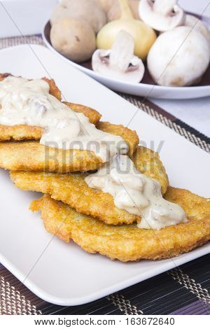 potato pancakes with mushroom sauce , copy space