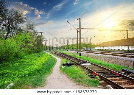 Electric poles on a railway station at sunrise