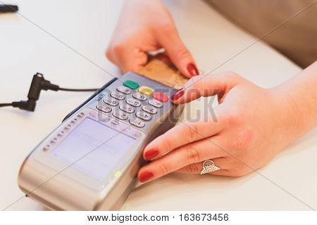Moment Of Payment With A Credit Card Through Terminal.