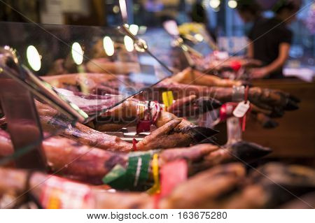Jamon shop. Blurred background. Piese of ham