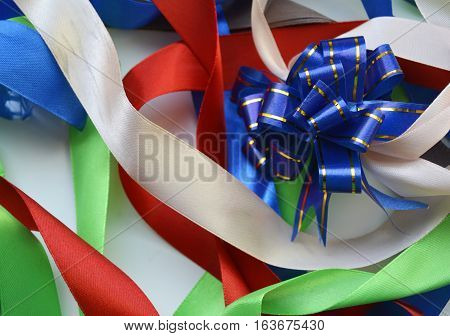 colored tape, ribbon, silk ribbon, assorted colors, rainbow, bright colors, paint, bright colors, background, fabric, texture of fabric, sewing, sewing, holiday decor, home decor, decorating, decorate, furniture, a cheerful mood, cheerful, color, colorful
