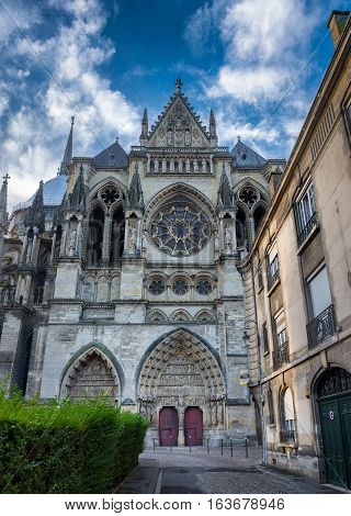 Lateral entrance of historic Reims cathedral, Champagne France