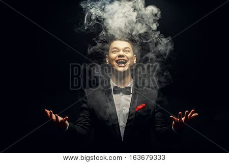 Emotion young Magician playing with Magic smoke
