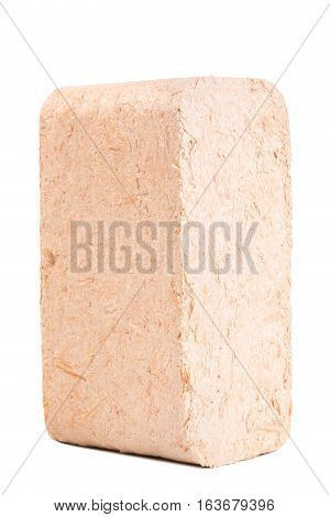 Briquettes made of sawdust lie on a white background.