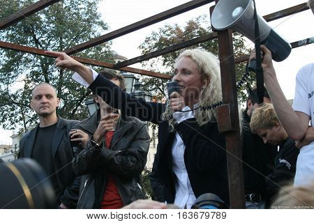 Moscow, Russia - August 22, 2010. Singer Katya Gordon speaks at a rally in defense of Khimki forest, Pushkin square