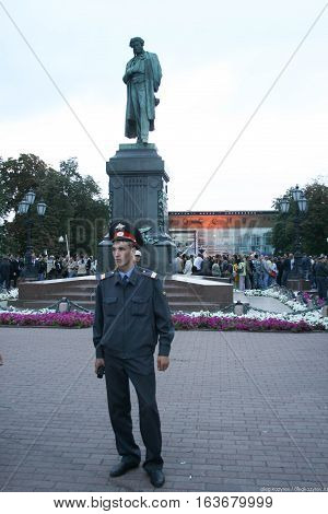 Moscow, Russia - August 22, 2010. Unidentified police officer and the monument to Pushkin. Rally in defense of Khimki forest, Pushkin square