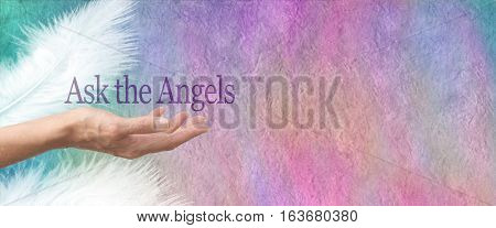 Ask Your Angels Parchment Banner - Female hand face up with the words Ask the Angels floating above on a  pastel colored rough parchment stone effect background with two white feathers and copy space