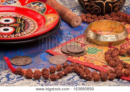 Various objects lying on the Indian fabric