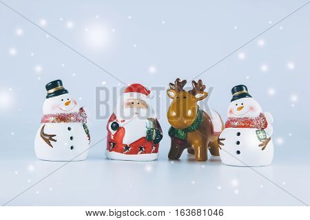 Santa Claus And Reindeer Stand With Gang Of Snowman