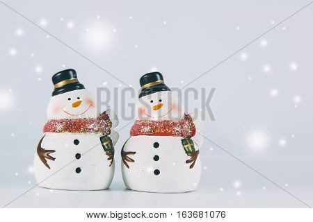 2 Snowman Stand On White Background