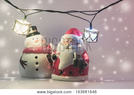 Santa Claus And Reindeer With Light Bulb