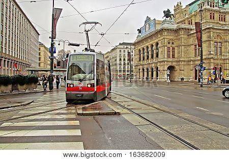 VIENNA, AUSTRIA - JANUARY 2, 2008: Public transportation with tram near Vienna State Opera at the city center of Austria's capital city Vienna.