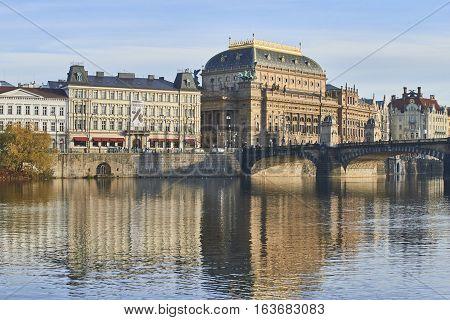 Prague, Czech Republic. November 20 - 2016: Beautiful Prague National Theatre at sunset along the river Vltava. Prague, Czech Republic