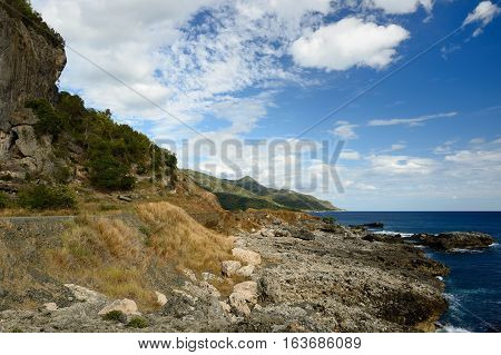 Wild Cuban coast in the vicinity of a Pico Turquino high mountain nearest Santiago de Cuba city Cuba