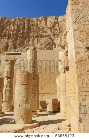 ancient Egyptian hieroglyphics and pillars in the ruins of the temple of Karnak in Luxor Egypt Africa at sunset