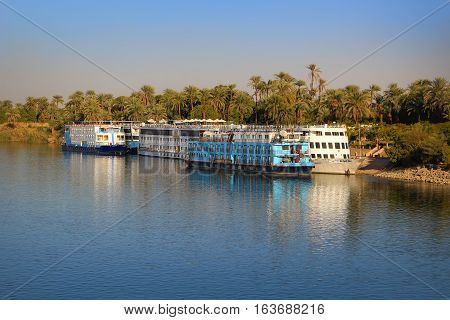 Luxor EGYPT - FEBRUARY 2 2016: Boats docked and along the shore waiting for the next Nile River cruise at Luxor Egypt