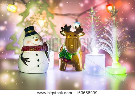 Reindeer And Snowman Stand Near Christmas Tree.