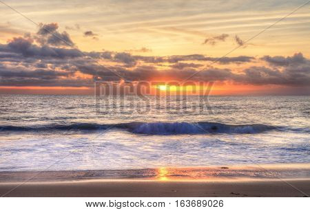 Sunset over the ocean at One Thousand Steps Beach in Laguna Beach, California, USA