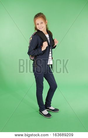 Young school girl with backpack - isolated over white