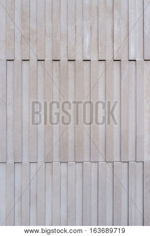 Modern clean stone facade, detail sandstone buildings, background dissected contemporary stone facade