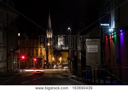 BATH UK - December 26 2016: Mandalyns Bar and spires of Bath at night. Bath Abbey and church spire lit up in the UNESCO World Heritage city in Somerset UK