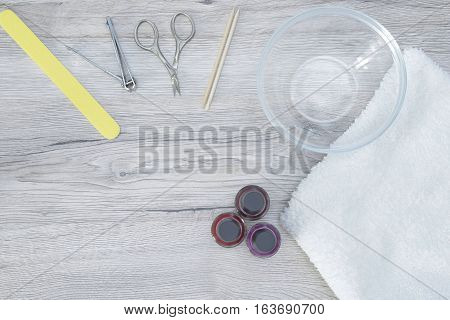 Different manicure tools on a wood table