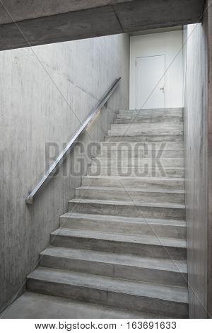 Reinforced concrete stairway inside building, modern interior concrete stairs