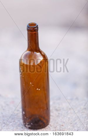 forgotten wine bottle outdoor. Abuse and alcoholism problems