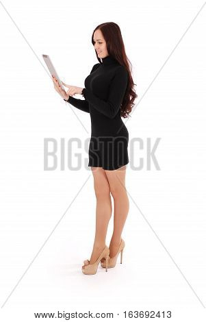 Girl looking at white tablet pc isolated on white