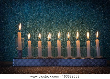 Menorah with glitter lights of candles is traditional symbol for Jewish Hanukkah Holiday