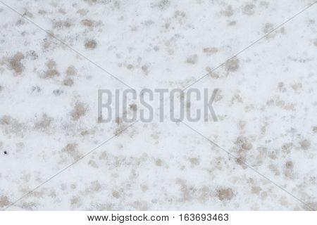 dark sprayed road snow on white side walk snow grunge grim texture