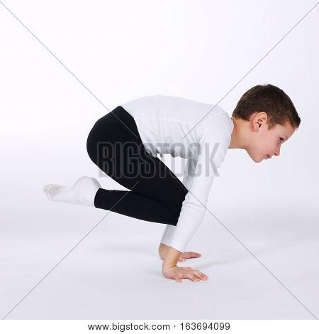photo of young gymnast on white background