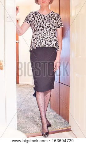 Smartly dressed attractive woman getting ready to go out.