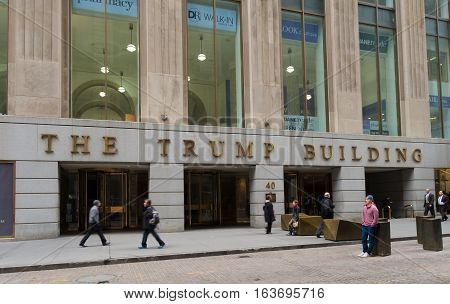 NEW YORK - APRIL 27 2016: Entrance of the Trump building with unknown people in front of it