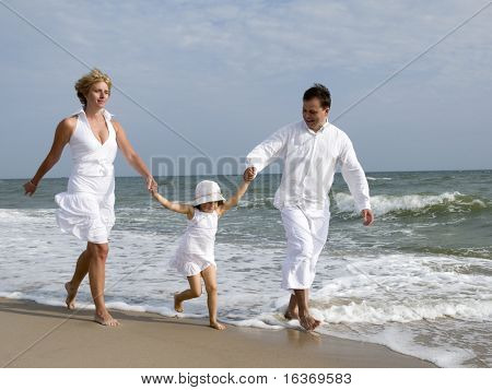 happy summer vacation - family playing on the beach