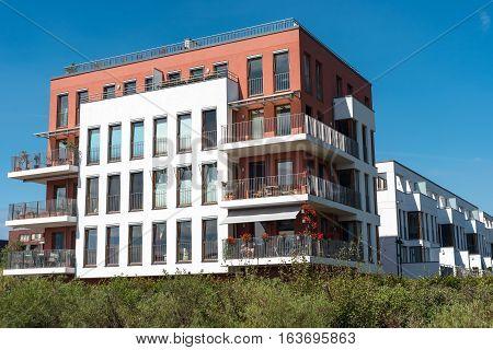 Modern townhouses under a blue sky seen in Berlin, Germany