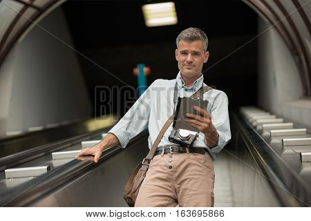 Tourist On The Escalator