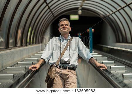 Confident Businessman On The Escalator