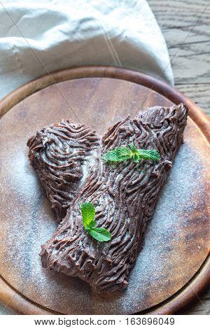 Yule Log On The Wooden Board