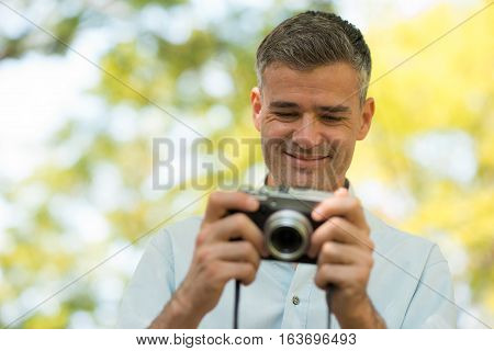 Photographer Watching His Pictures