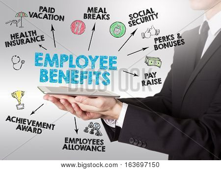 Employee Benefits Concept, young man holding a tablet computer.