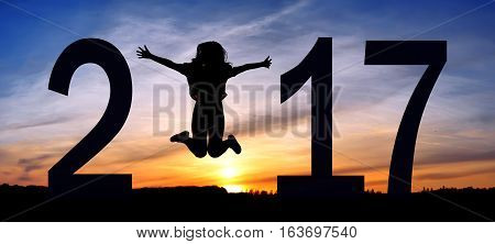Silhouette young woman jumping on the sea and 2016 years while celebrating new EAP, 2016, happy girl. silhouette of girl at sunset, jumping on the background of sunset
