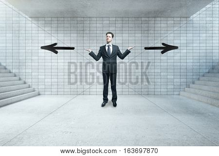 Different direction concept. Young businessman not sure where to go