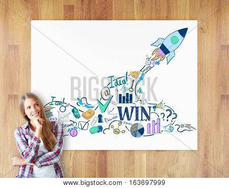 Cheerful daydreaming woman on wooden background with rocket ship sketch on whiteboard. Start up concept