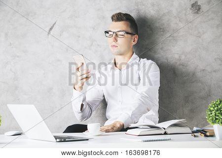 European Male Using Smartphone