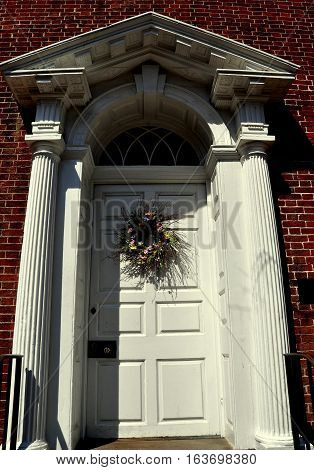 alexandria virginia - april 13 2014: georgian doorway with columns pediment and fan window at the historic 1770-1792 gadsby's tavern on n. royal street