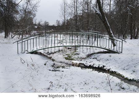 bridge over the river in winter sunny day
